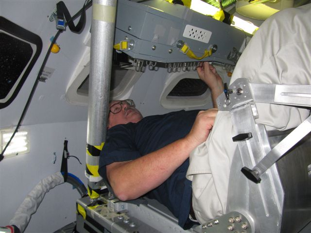Jim in Orion capsule trainer crew seat